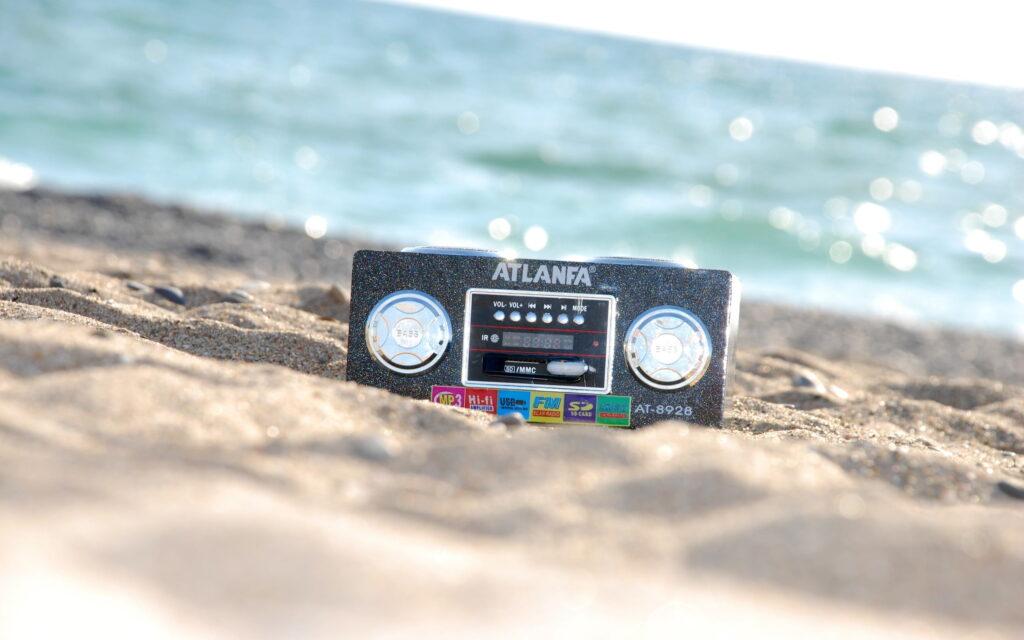 Portable radio on beach