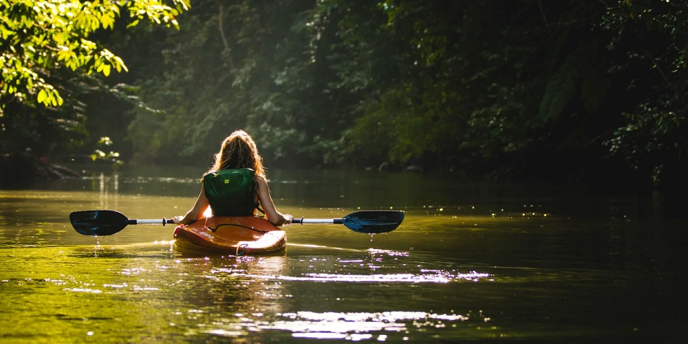 Woman with Jacket in Kayak